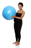 Pregnant woman excercises with gymnastic ball Royalty Free Stock Image