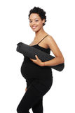 Pregnant woman excercising Royalty Free Stock Photography