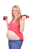 Pregnant woman exercise with dumbells Royalty Free Stock Images