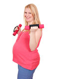 Pregnant woman exercise with dumbells Stock Photo