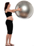 Pregnant Woman Exercise with fitness ball Stock Photography