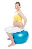 Pregnant woman exercises with gymnastic ball Royalty Free Stock Photo