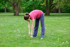 Pregnant woman exercising. In the park Royalty Free Stock Images