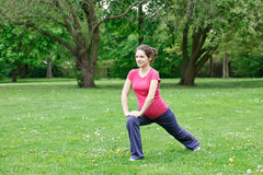 Pregnant woman exercising. In the park Stock Photo