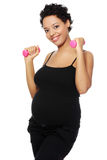 Pregnant woman during exercising. Stock Photo