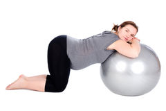 Pregnant woman exercising Royalty Free Stock Image