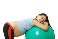 Pregnant woman exercising royalty free stock photography