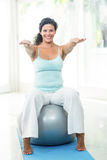 Pregnant woman exercising with ball Royalty Free Stock Photography