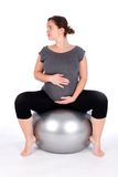 Pregnant woman exercising Royalty Free Stock Photo