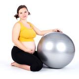 Pregnant woman exercising Stock Photo