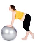 Pregnant woman exercising Royalty Free Stock Images
