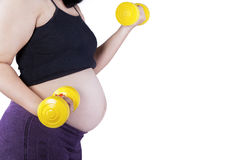 Pregnant woman exercising with dumbbells Royalty Free Stock Photo