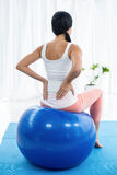 Pregnant woman exercising on exercise ball Stock Images