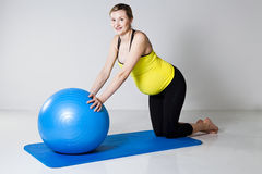 Pregnant woman exercising with fitness ball Royalty Free Stock Photos