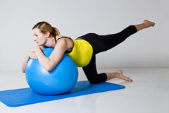 Pregnant woman exercising with fitness ball Stock Photography
