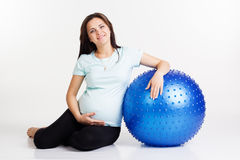 Pregnant woman exercising fitness with ball Royalty Free Stock Photo