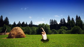 Pregnant woman exercising on green meadow, stock footage Stock Image
