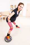 Pregnant woman exercising at home Stock Image
