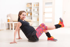 Pregnant woman exercising at home Royalty Free Stock Images