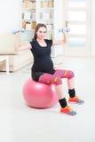 Pregnant woman exercising at home Royalty Free Stock Photo