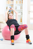 Pregnant woman exercising at home Royalty Free Stock Photography