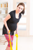 Pregnant woman exercising at home Stock Images