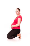 Pregnant woman exercising isolated on white Royalty Free Stock Image