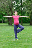 Pregnant woman exercising in the park Royalty Free Stock Images