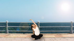 Pregnant woman exercising at seaside, stock footage Royalty Free Stock Image