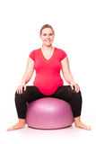 Pregnant woman exercising  on white Stock Photos