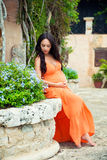 Pregnant woman in an exotic medieval village Altos de Chavon. Dominican Republic Royalty Free Stock Image