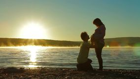 A Pregnant Woman And Expectant Father On Lake stock video footage