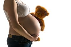 Pregnant woman, expectant mother on white background, close-up of pregnant belly. Activity during pregnancy stock photos