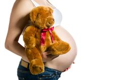 Pregnant woman, expectant mother on white background, close-up of pregnant belly. Activity during pregnancy stock image