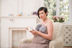 Pregnant woman expecting her baby Royalty Free Stock Photos