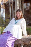 Pregnant woman in fall nature Stock Images