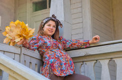 Pregnant woman in the fall Royalty Free Stock Photos
