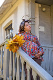 Pregnant woman in the fall Royalty Free Stock Images