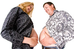 Pregnant woman and fat man Royalty Free Stock Photography