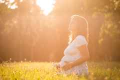 Pregnant woman feeling baby Royalty Free Stock Photography