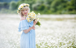 Pregnant woman in a field of blooming white daisies Stock Photography