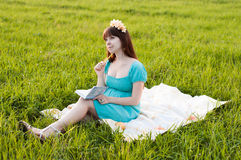 Pregnant woman in the field Royalty Free Stock Photo
