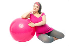 Pregnant woman with a fitness ball Stock Image