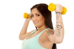 Pregnant woman fitness blue weights up flex side Stock Photo