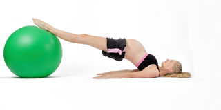 Pregnant Woman Fitness. Exercise Ball Hip Raise Stock Photo