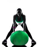 Pregnant woman fitness exercises silhouette. One caucasian pregnant woman exercising fitness exercises in silhouette studio isolated on white background royalty free stock images
