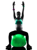 Pregnant woman fitness exercises silhouette. One caucasian pregnant woman exercising fitness exercises in silhouette studio isolated on white background stock images