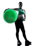 Pregnant woman fitness exercises silhouette. One caucasian pregnant woman exercising fitness exercises in silhouette studio isolated on white background stock image