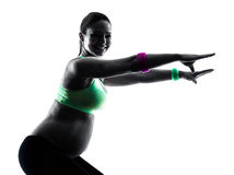 Pregnant woman fitness exercises silhouette stock image
