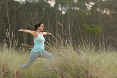 Pregnant fitness woman doing yoga exercise outdoor Royalty Free Stock Photography